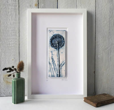 Blue plaster cast of Allium seed head mounted in a white frame