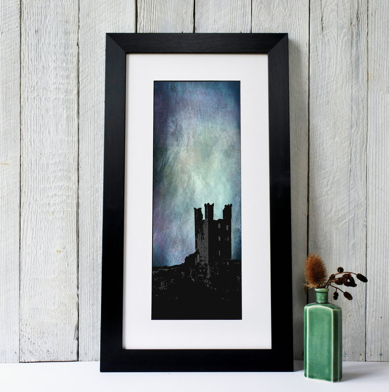 Silhouette Image of Dunstanbrough Castle against a dramatic Blue and Purple sky. Fiona Gray Print
