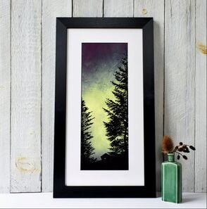 Silhouette of a wooden forest cabin nestled deep in a Pine forest. By Fiona Gray