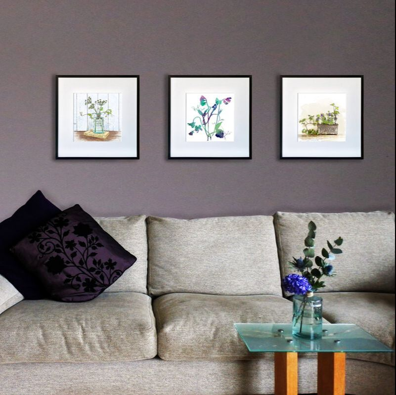 Fiona Gray Botanical watercolour effect prints displayed in a lounge setting