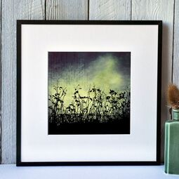 Fiona Gray 'Urban Light' print. Depicting a dramatic Blue & Yellow sky behind urban flower silhouettes