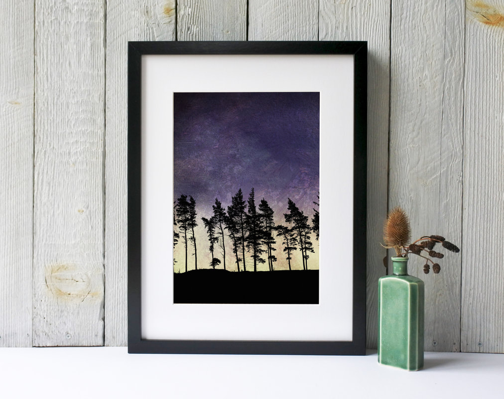 Northumberland Tree ridge silhouetted against a dramatic sky of purple & yellow print by Fiona Gray
